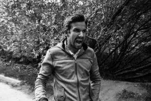black and white image of a man angry