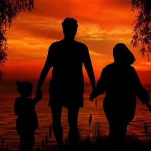 family walking in sunset