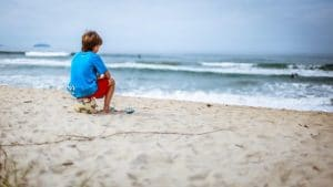 child by himself on beach